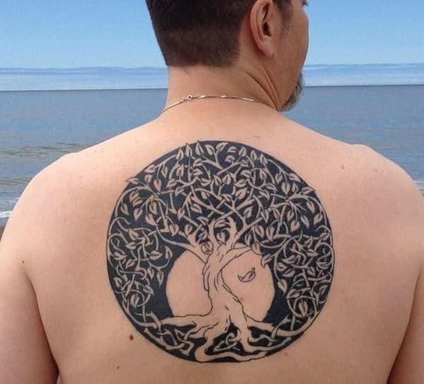 Circular Mens Twisted Knot Tree Tattoo On Man