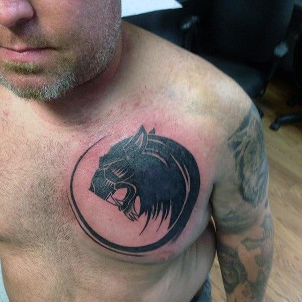 Circular Tribal Lion Male Tattoo On Chest