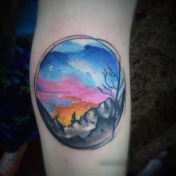 Circular Watercolor Painting Tattoo On Legs For Men
