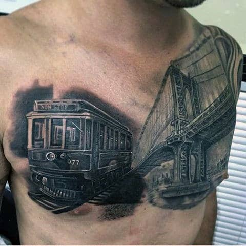 City Train Tattoo For Males On Chest With Bridge