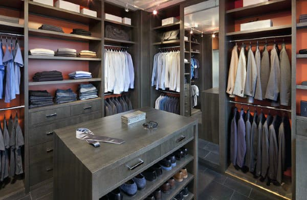 Classic Mens Wood Walk In Closet With Red Painted Walls