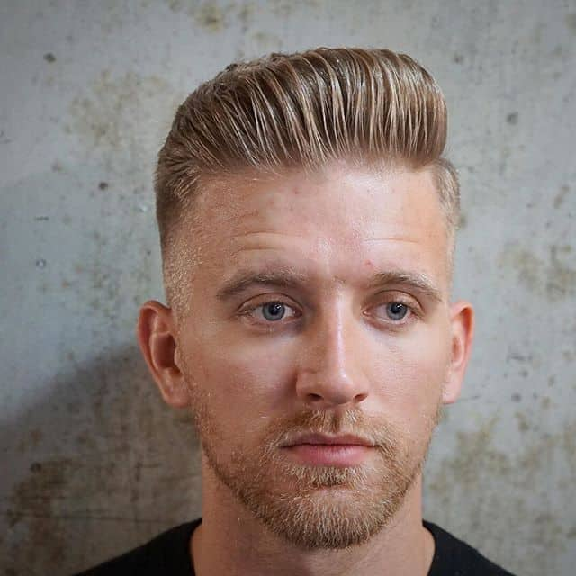 Back-combed hair with a medium fade