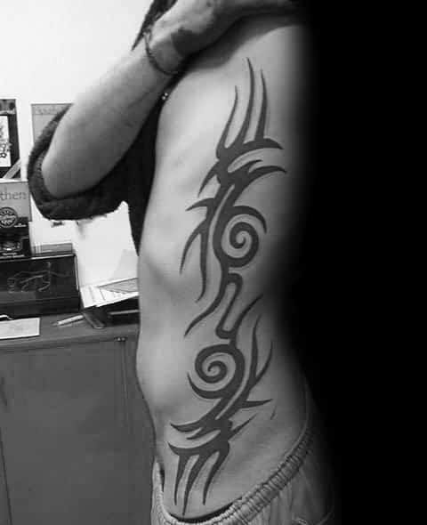 Classic Solid Black Ink Male Decorative Tribal Rib Cage Tattoo Inspiration