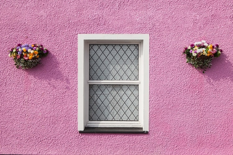 Classic White Stucco Exterior Window Trim In Pink Wall