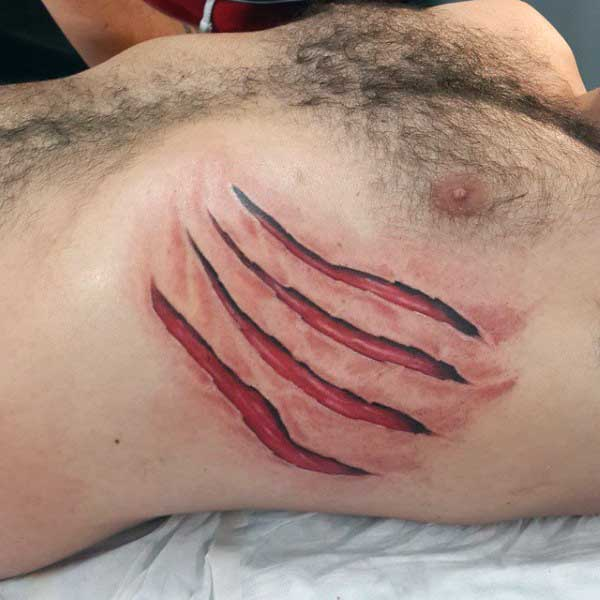 Claw Red Torn Ripped Skin Tattoo Designs On Upper Ribs
