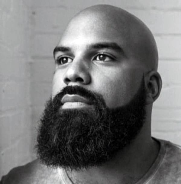 Clean Shaved Head With Full Beard Style For Black Men