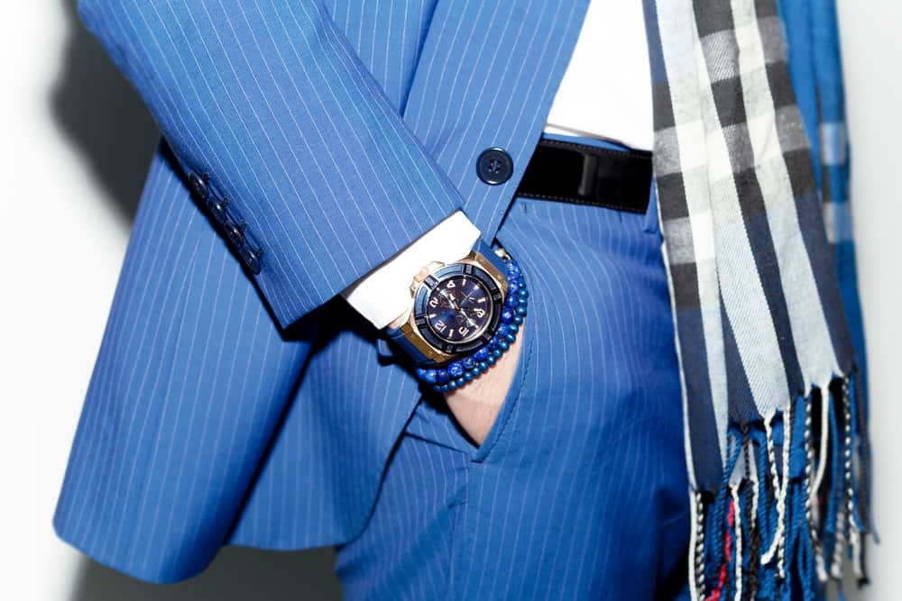 closeup fashion of man wearing blue suit with watch on wrist