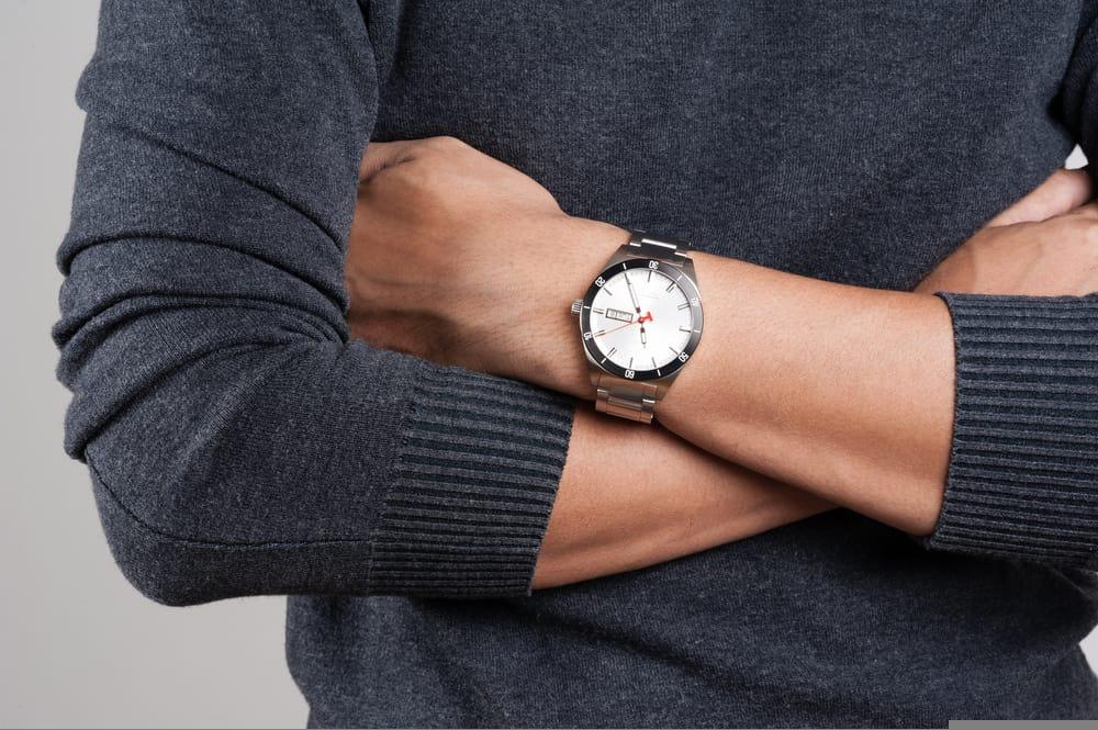 closeup of luxury wrist watch on man hand