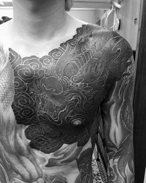 Clouds With Dragon Blackwork White Ink Mens Chest Tattoos