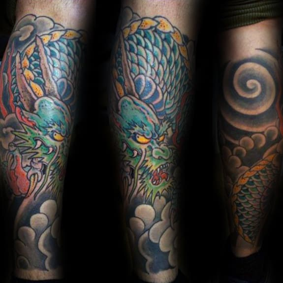 Clouds With Green Dragon Mens Leg Tattoo Ideas