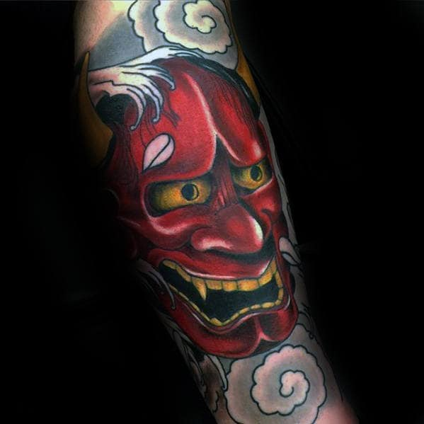 Clouds With Red Japanese Demon Hannya Mask Tattoo On Guys Forearm