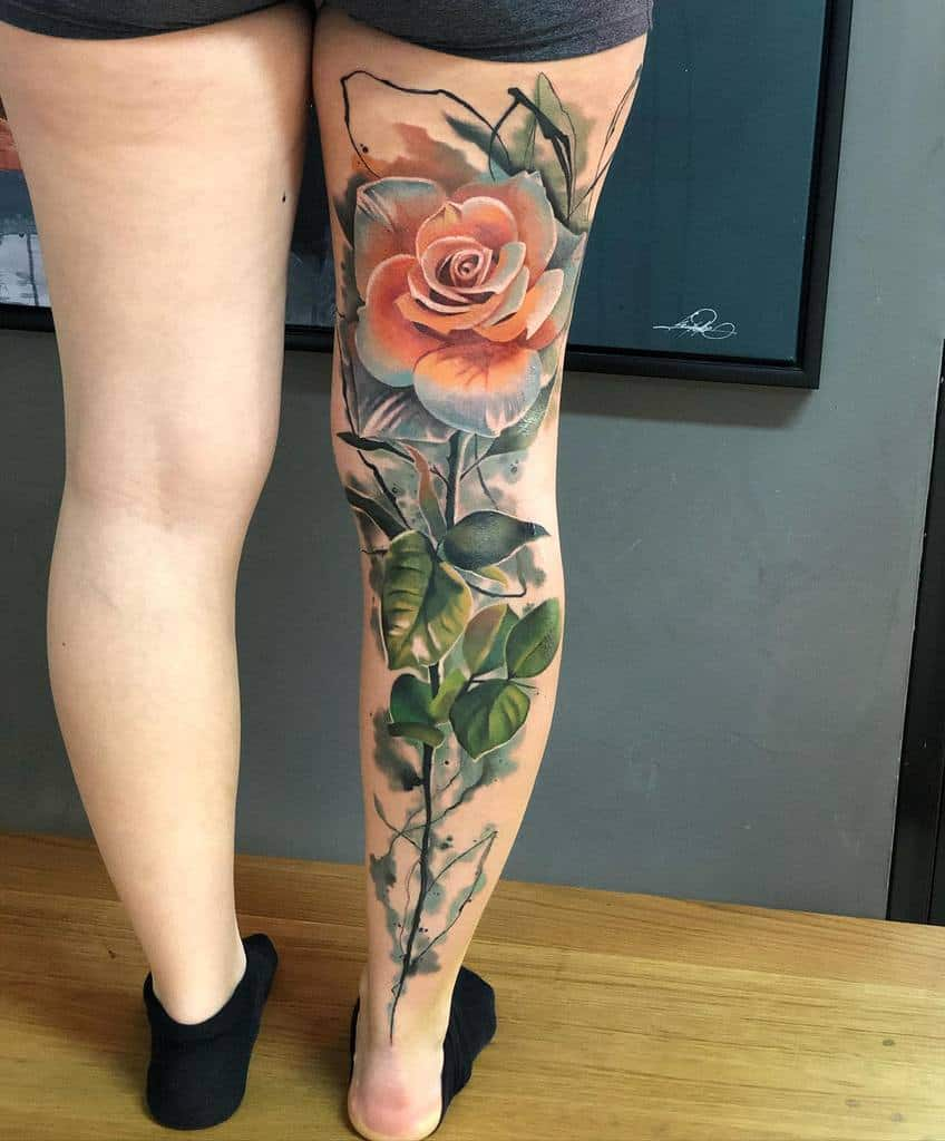 Color flower leg sleeve tattoo