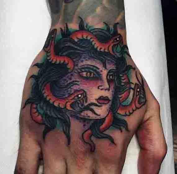 Color Orange Snake Medusa Face Tattoo On Hand For Men