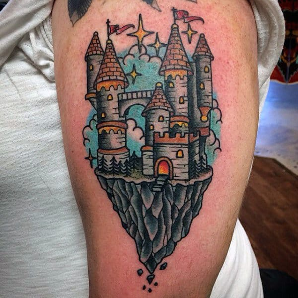 Colorful Castle On Crumbling Cliff Mens Bicep Tattoo