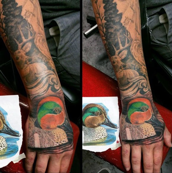 Colorful Orange And Green Duck Tattoo On Mans Hand
