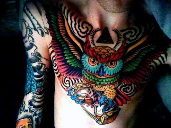 Colorful Owl Flying With Hourglass Male Tattoos