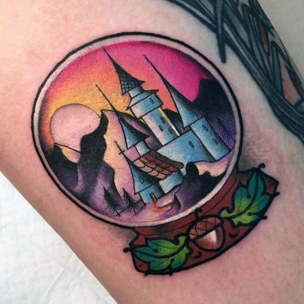 Colorful Small Castle Snow Globe Tattoo Design On Man