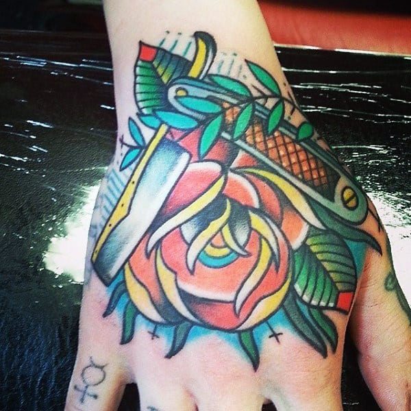 Colorful Tattoo Of Flowers And Straight Razor Male Hands