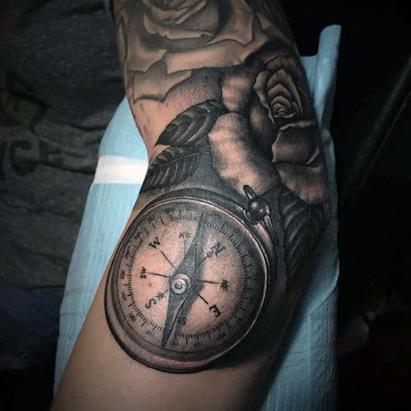 Compass And Rose Male Tattoo On The Elbow