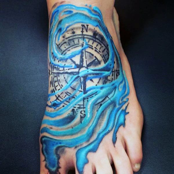 Compass With Azure Sea Waves Tattoo On Foot For Men