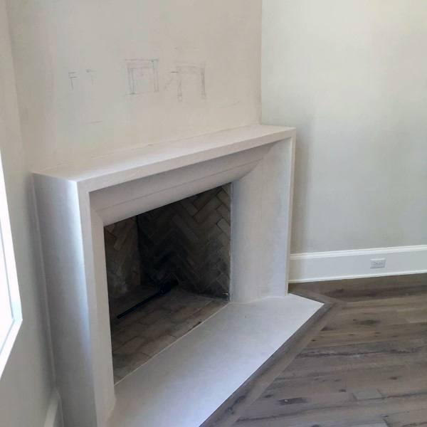 Concrete Mantel Wood Burning Corner Fireplace Design
