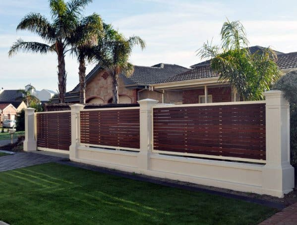 Concrete With Wood Slat Boards Cool Front Yard Fence & Top 60 Best Front Yard Fence Ideas - Outdoor Barrier Designs