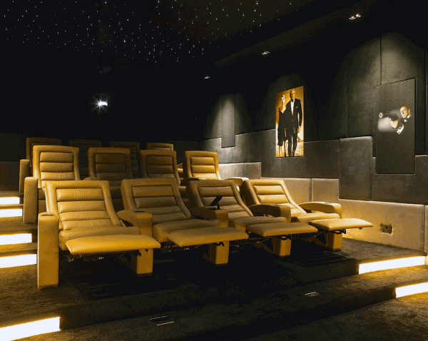 Contemporary Black Home Theater With Yellow Lounge Chair Seating