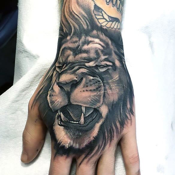 Cool Angry Lion Hand Tattoos For Guys