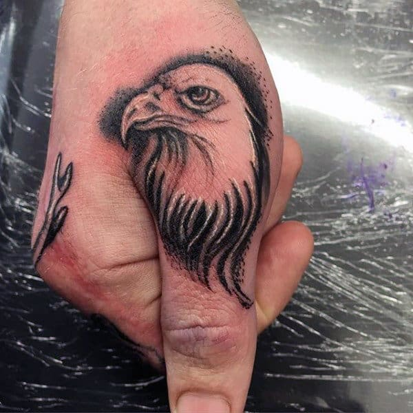 Cool Bald Eagle Thumb Tattoo On Man