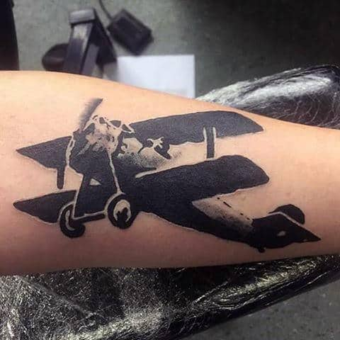 Cool Banksy Plane Tattoo On Arm For Men