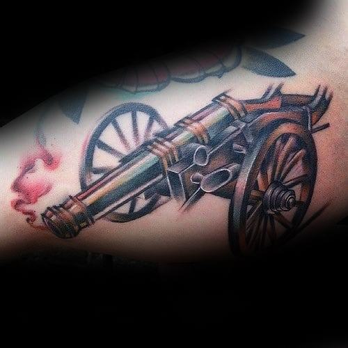 Cool Cannon Tattoo Design Ideas For Males On Inner Arm Bicep