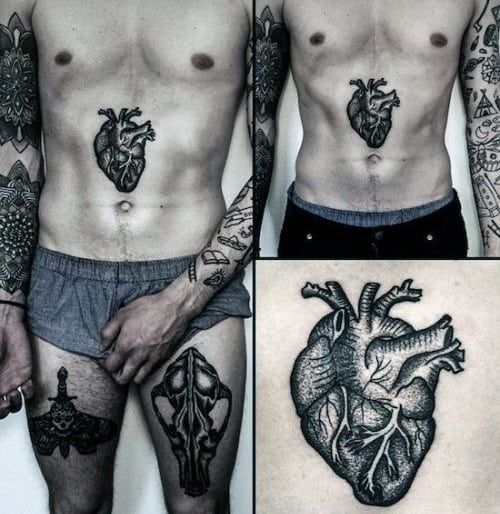Cool Center Of Stomach Heart Tattoo On Man