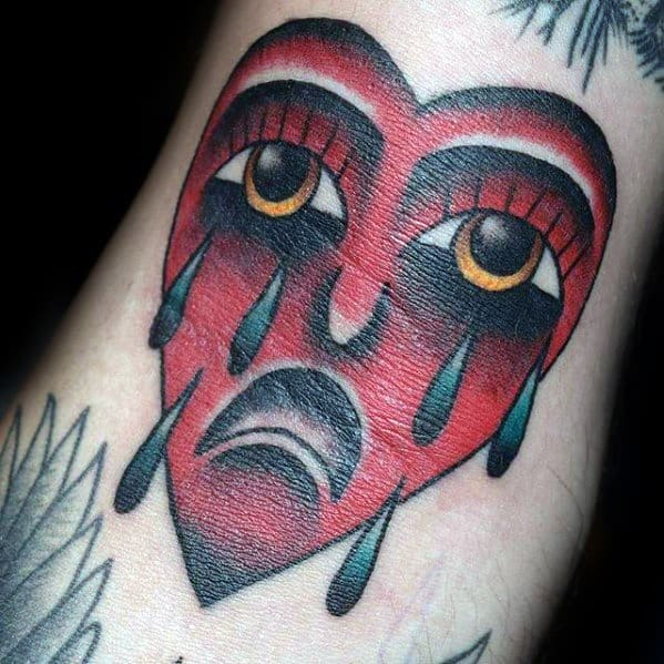 Cool Crying Red Heart With Tears Ditch Tattoo Design Ideas For Male