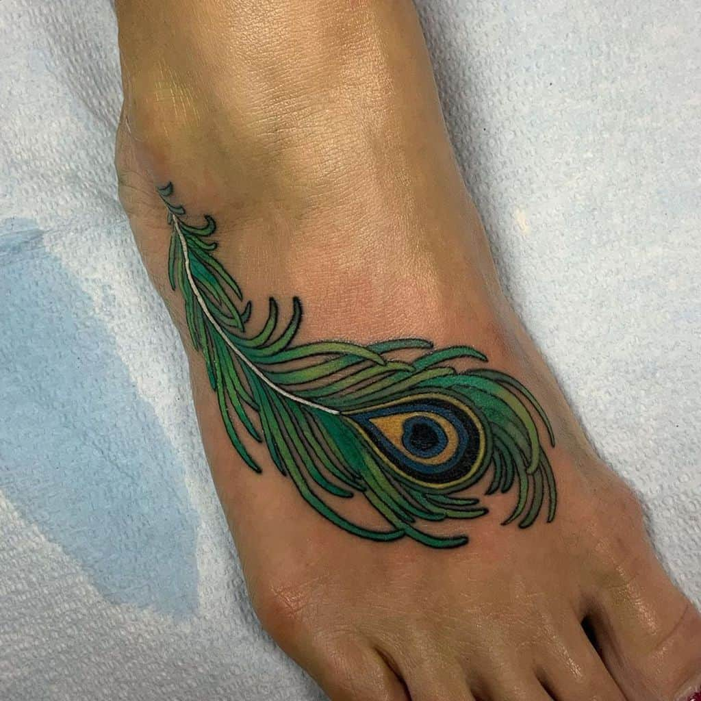 Cool Foot Peacock Feather Tattoo