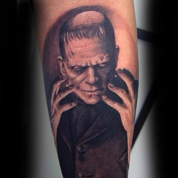 Cool Frankenstein Looking At Hands Tattoo For Guys On Leg