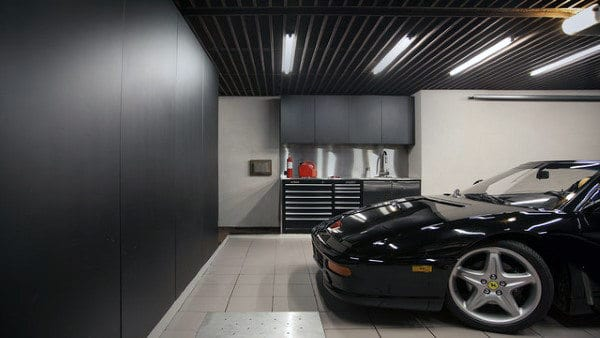 Cool Garage Lighting Layout With Black Ceiling And Cabinets