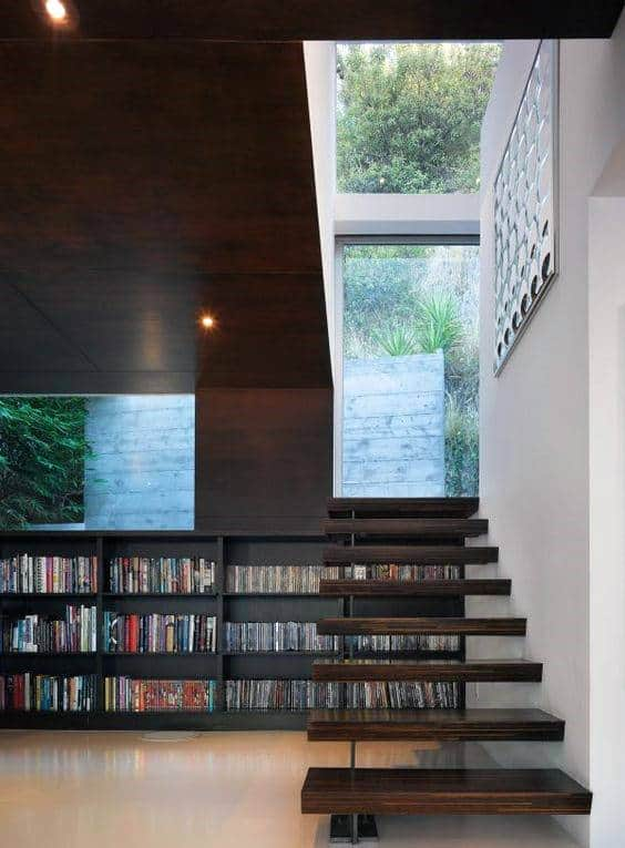 Cool Home Library Under Staircase