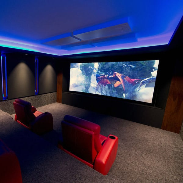 Cool Home Theater Design With Neon Blue Light Up Celing And Red Lounge  Chairs