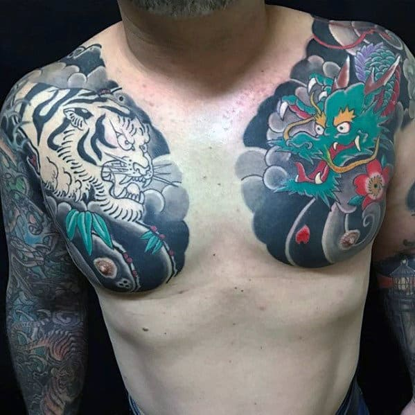 Cool Japanese Dragon And Tiger Upper Chest Guys Tattoo Ideas