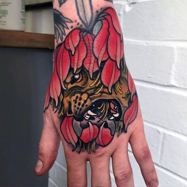 Cool Magenta Leaved Horrific Face Tattoo On Male Hands