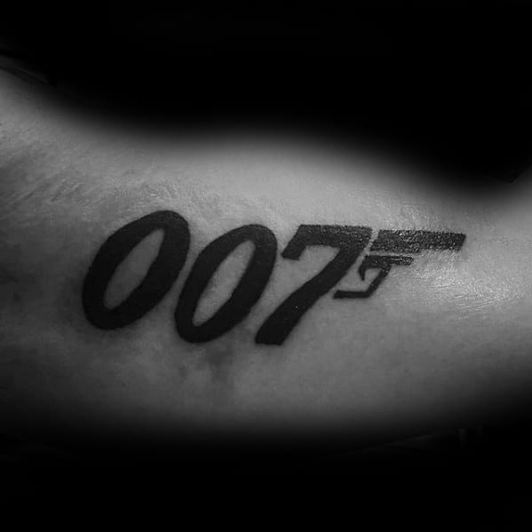 Cool Male James Bond 007 Tattoo Designs On Inner Arm Bicep