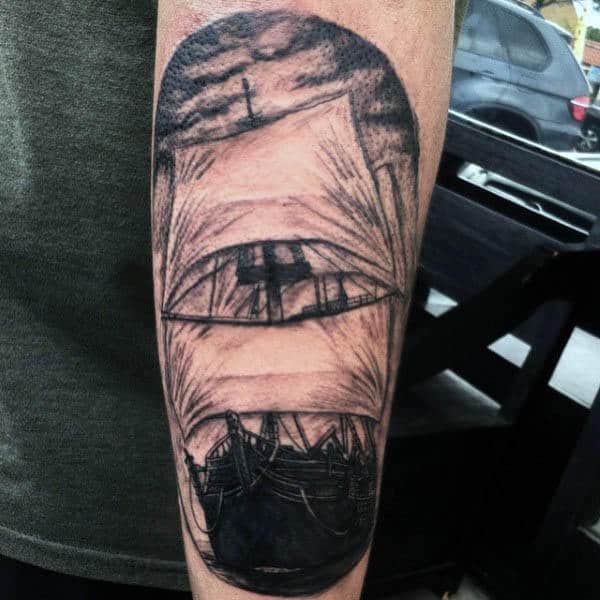 Cool Mens Arm Sailing Ship Tattoo In Black Ink
