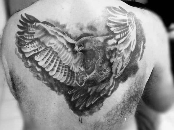 Cool Mens Flying In Air Shaded Eagle Tattoo Design On Back