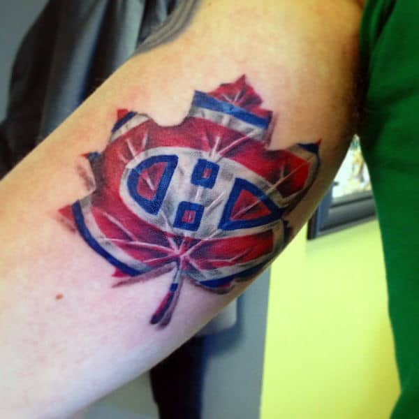 Cool Mens Leaf Hockey Logo Tattoo On Inner Arm Bicep