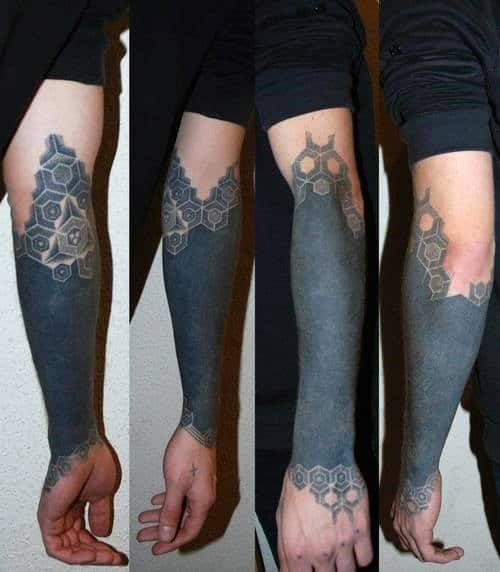 Cool Mens Wrist And Forearm Blackwork Tattoo With Pattern At Top And Bottom Of Design