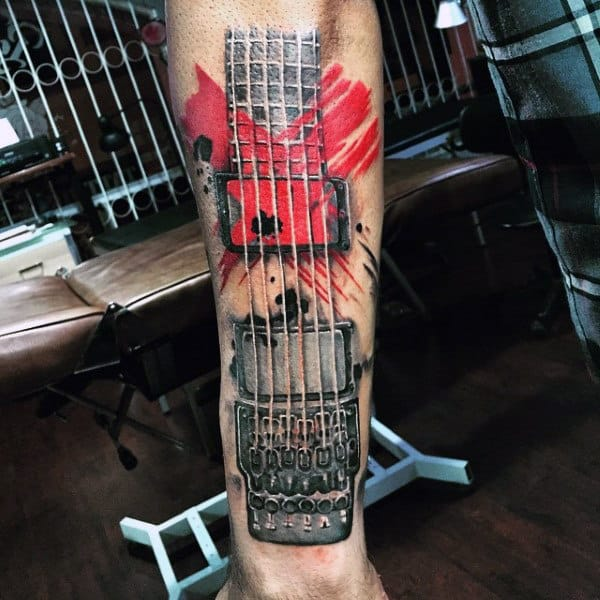 Cool Musical Tattoo With Red Strokes Tattoo On Legs For Men
