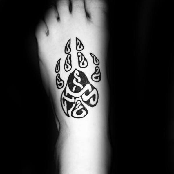 Cool Negative Space Wolf Paw Foot Tattoo On Gentleman