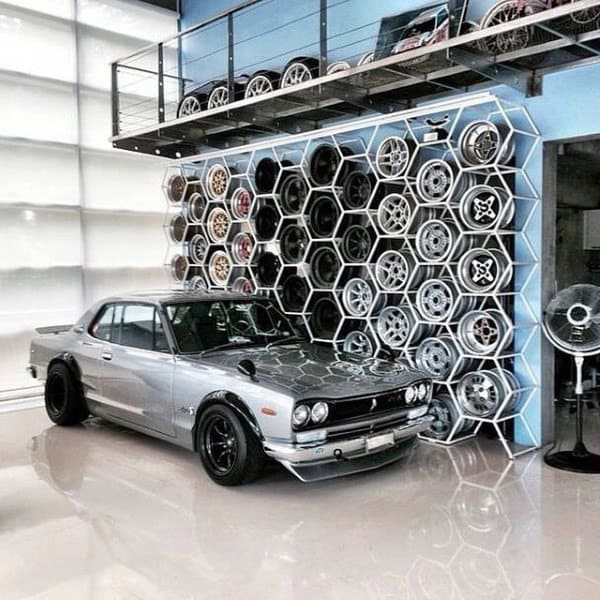 Cool Nissan Skyline In Dream Garage With Wheel Shelving On Wall