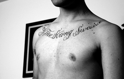 Cool Only The Strong Survive Male Chest Tattoos