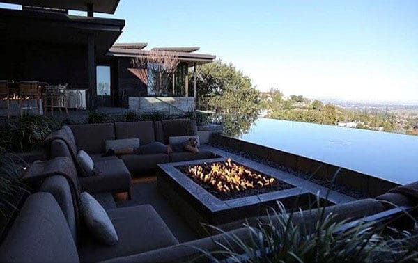 Cool Outdoor Fireplace With Infinity Edge Pool